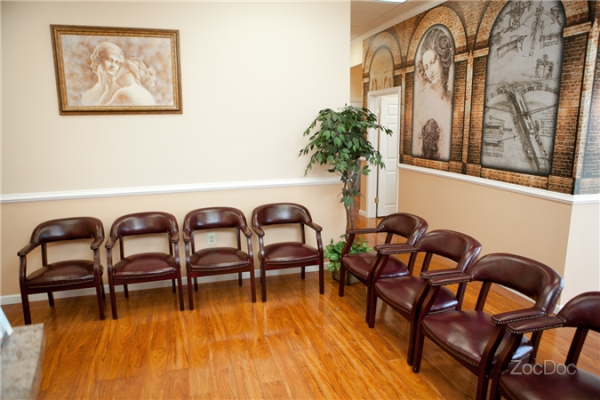 A waiting room with chairs lined up in an L shape